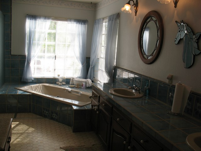 There is a lot of room in the master bathroom, and there are several cabinets for linens and toiletries.