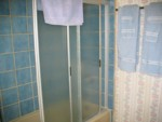 This is another full bathroom. It is located between the blue and the light green bunk bedrooms.