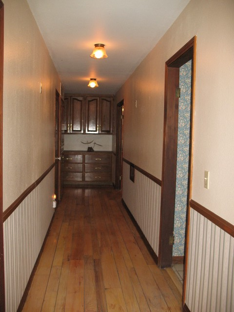 This is the main hallway. On the front right is an entryway to the kitchen. On the rear right is the entryway to the master bedroom. The door at the front left is to the blue bunk bedroom. The door at the rear left is to the light green bunk bedroom. The far door on the left (right beside the cabinets and drawers) is the main linen closet, which is filled with extra bedding and extra towels. The cabinets and drawers at the end of the hall are filled with lots and lots of cards and board games. Can anyone say scrabble, or better yet
