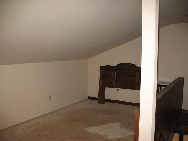 This is the upstairs bedroom that is currently being renovated.  There will be a queen size bed and a sofa in this room. This room will sleep two - three people. You can see the rail and stairs that lead down to the great room. On the other side of the rail and stairs, is a closet and dressing area.