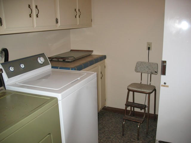 Fully stocked (soap and stuff) laundry room (behind the kitchen) with washer and dryer. To the right of the step stool is the full size freezer and I think a wash basin.