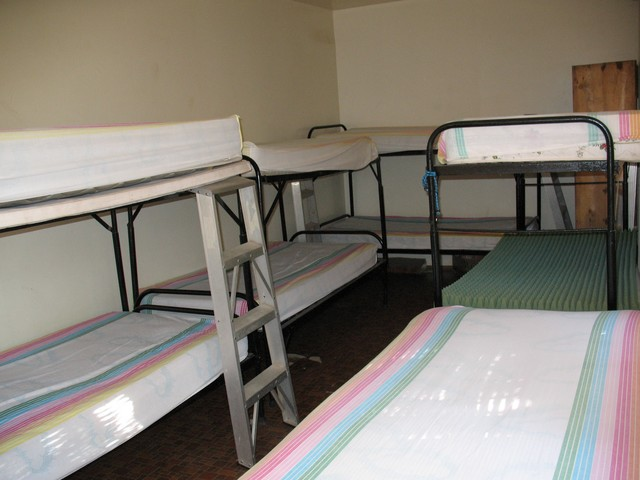 Ready for a slumber party? This is one of two bunk rooms on the ranch that sleeps up to nine people for a total of eighteen with both rooms being filled. We can rent this area also, if we need to.  Bedding will be provided.