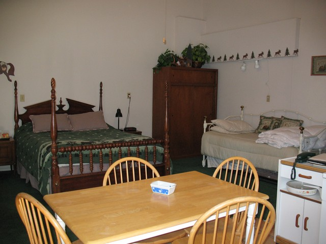 Here you can see the big bed a king or queen that sleeps two, so a total of four people can sleep in this room. On the right you can see the closet for hanging clothes.