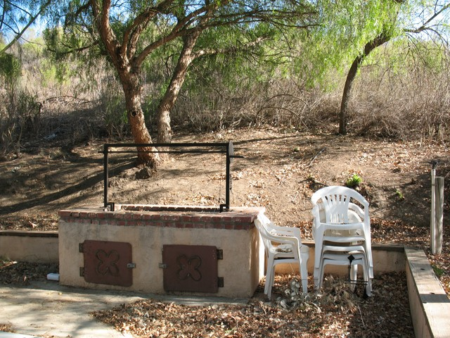 This is the big, big barbeque area. It is located in a very pretty area on the property in a gove of pine trees.  They have tables and chairs for us to use. It will be cleaned up. This picture was taken after the Santa Ana winds blew the fall leaves to the ground.